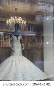 Wedding dress in the window and the reflection of the city