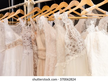 wedding dresses hanging on racks