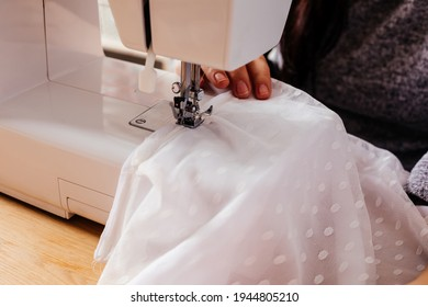 Wedding dressmaker altering white vintage wedding dress