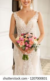Wedding. Elegant bride with wedding bouquet of fresh flowers