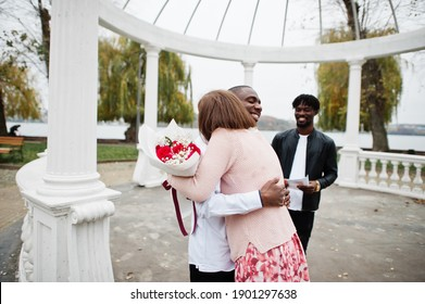 Wedding engagement ceremony with pastor. Happy multiethnic couple in love story. Relationships of african man and white european woman.