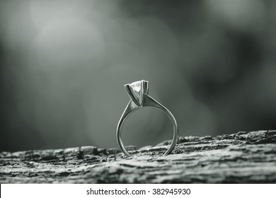 Wedding or engagement ring with nice bokeh at the background black and white image