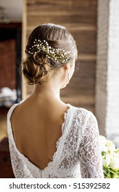 Wedding fashion bride with bouquet in hands