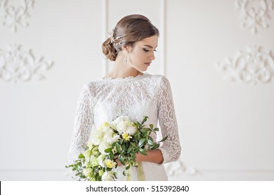 Wedding fashion bride with bouquet in hands