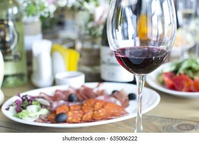 Wedding festive interior, table decorations, flowers, table setting, wine glass, pastel summer tones