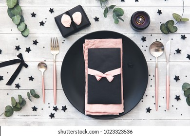 Wedding or festive table setting. Plates, candles and cutlery with decorative textile on wooden background. Rustic style