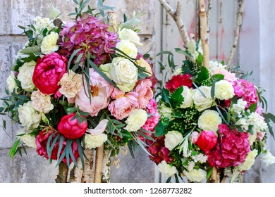 Wedding floral decoration with roses, peonies, hortensias, carnations and other flowers.