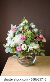 Wedding flower arrangement of chrysanthemums, roses  flowers and eucalyptus in glass vase. Close up. Selective focus