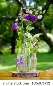 Wedding flower arrangement series. Bouquet of flowers for a wedding event in clear bottles