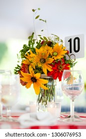 Wedding flower arrangement series. Bouquet of flowers for a wedding event on a table with yellow flowers