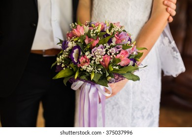 wedding flowers, wedding bouquet, the bride and groom sitting next to the bride girl holding a bridal bouquet of pink, blue and white flowers, wedding ceremony gown