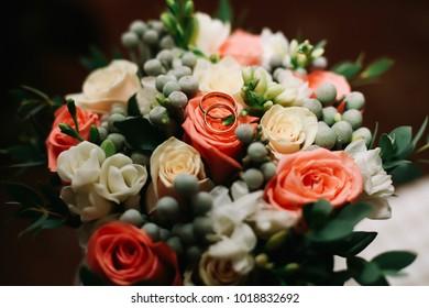 Wedding flowers. Wedding bouquet and wedding rings. Wedding details