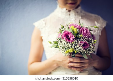 Wedding flowers bride ,Woman holding colorful bouquet with her hands on wedding day