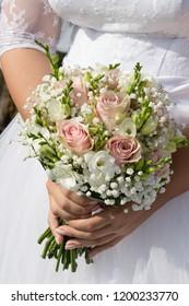 wedding flowers in hands of woman