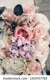 Wedding flowers with pink roses and violet hydrangea.