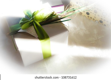 Wedding gift with green bow and sunlight