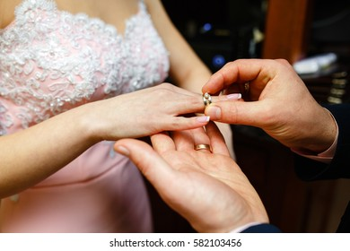 wedding.the girl wears an engagement ring on the finger of the beloved