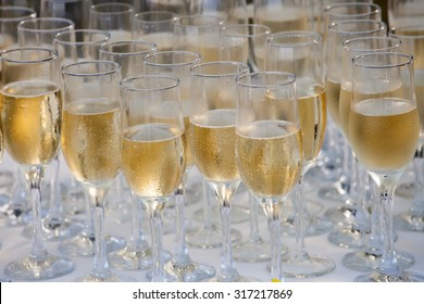 Wedding glasses filled with champagne, ready to be served