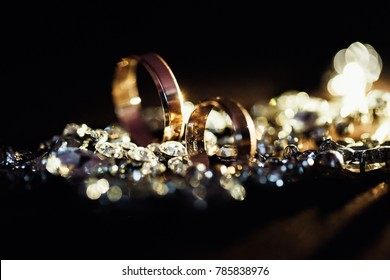wedding gold  rings with bokeh and light background