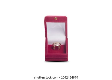 Wedding gold rings in red box isolated on a white background