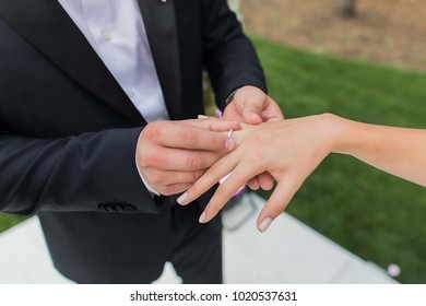 wedding. groom dresses the ring on the ring finger of the bride