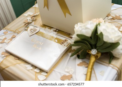 wedding guest book and bouquet on decorated table at wedding reception