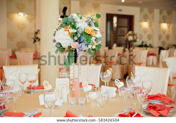 Wedding guest table decorated with bouquet and settings