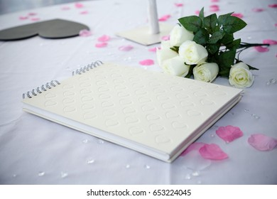 wedding guestbook next to flowers