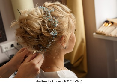 Wedding hairstyle and makeup. Makeup artist made makeup for beautiful bride at wedding day