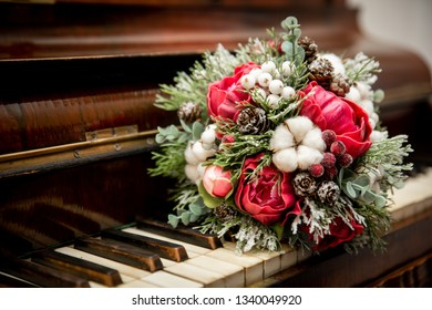Wedding hand made craft bouquet of the bride on a old piano.