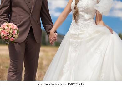 wedding, holding hands newlyweds