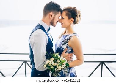 wedding in interior. Newlyweds kissing. Wedding photo shoot