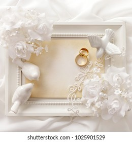 wedding invitation with flowers and wedding rings. frame, copy space for text