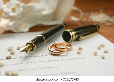 Wedding invitation with gold rings - closeup
