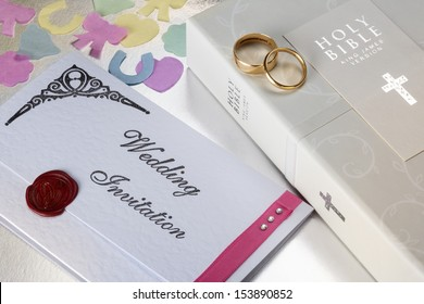 Wedding Invitation and Holy Bible.