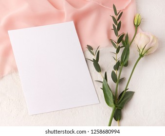 Wedding invitation mockup with blush silk , greenery and flowers