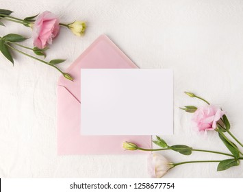Wedding invitation mockup with delicate blush flowers and pink envelope