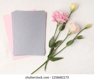 Wedding invitation mockup with delicate blush flowers