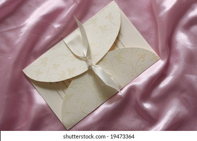 Wedding invitation on pink silk