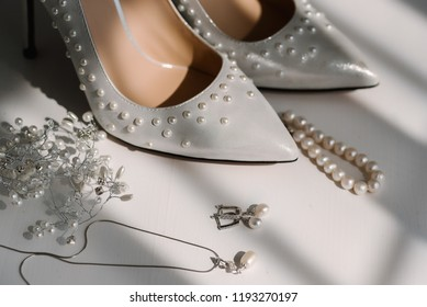 wedding items, pearl shoes, pendant and pearl earrings