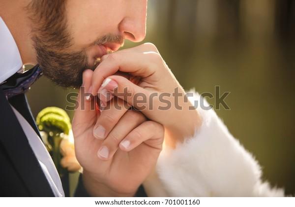 Wedding kiss. Groom kisses bride's hand. Weddng love