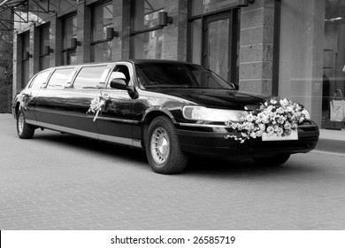 Wedding limousine near the shop