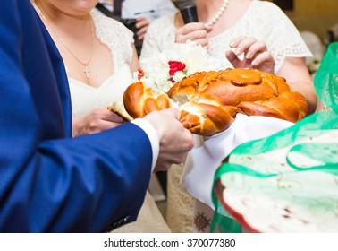wedding loaf being broken by bride and groom
