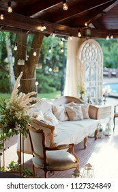 wedding lounge zone with sofa, boudoir table and lights