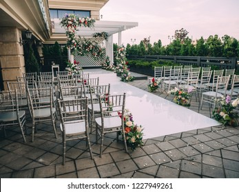 Wedding luxury place with arch and flowers.