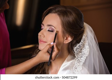 Wedding makeup. Makeup artist made makeup for beautiful bride at wedding day