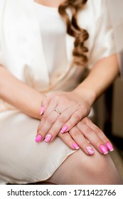 wedding manicure on the hands of the bride