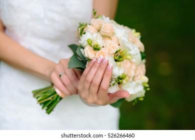 Wedding manicured nail. Bride woman french nails. Decorative closeup.