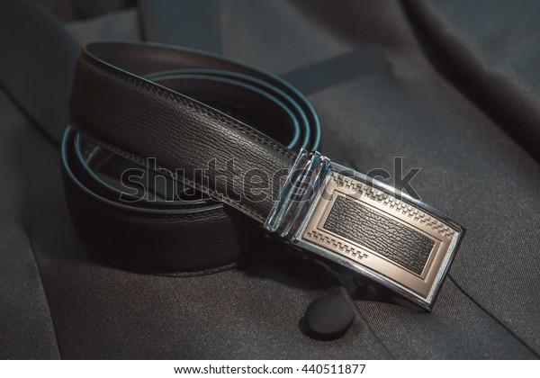 Wedding men's belt, lying on the floor
