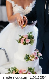 At the wedding, the newlyweds cut the wedding cake. Cake.